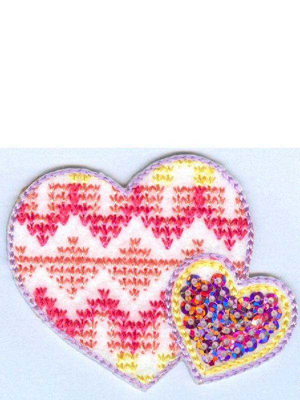 Laglapp två rosa hjärtan. Se fler laglappar och tygmärken hos Textil ... e1595a811e413